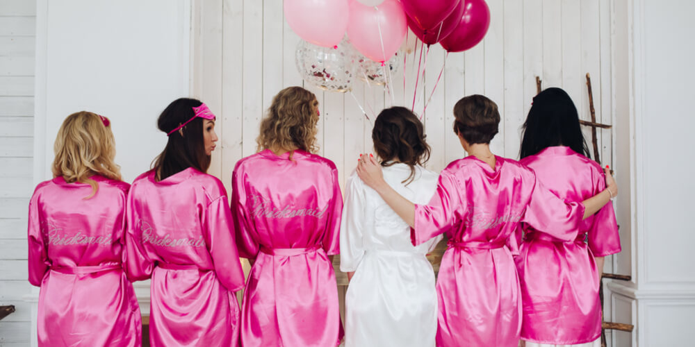 women on bachelorette party in matching pyjamas/robes