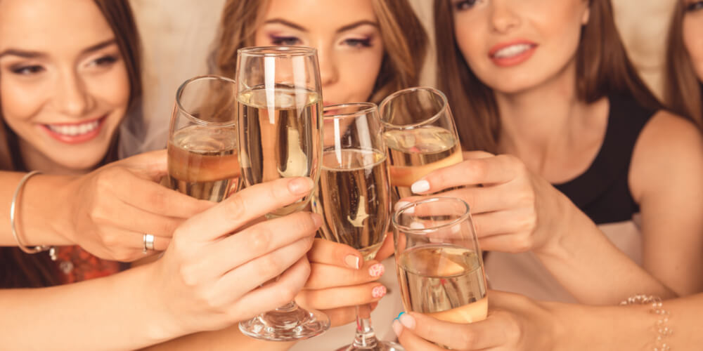 Women clinking champagne glasses