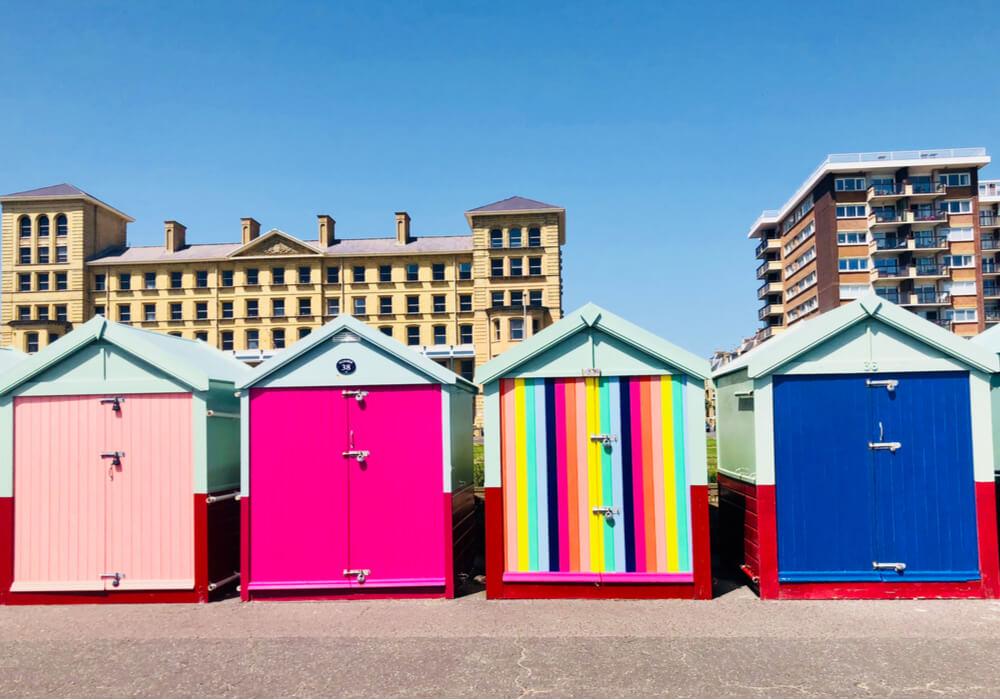 Brightly coloured beach huts in Brighton and Hove to celebrate Pride