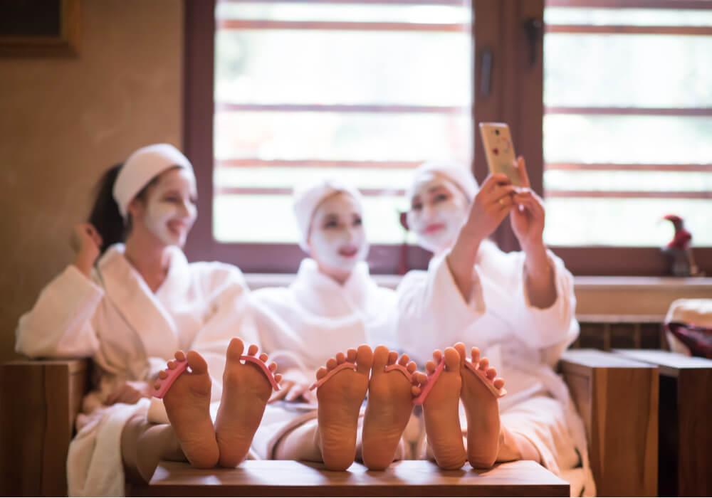 Women at a spa taking a selfie
