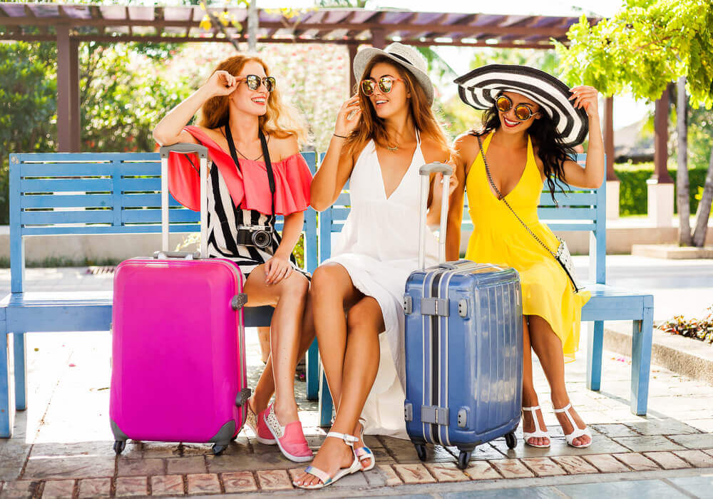 Women with suitcases about to go on a hen party