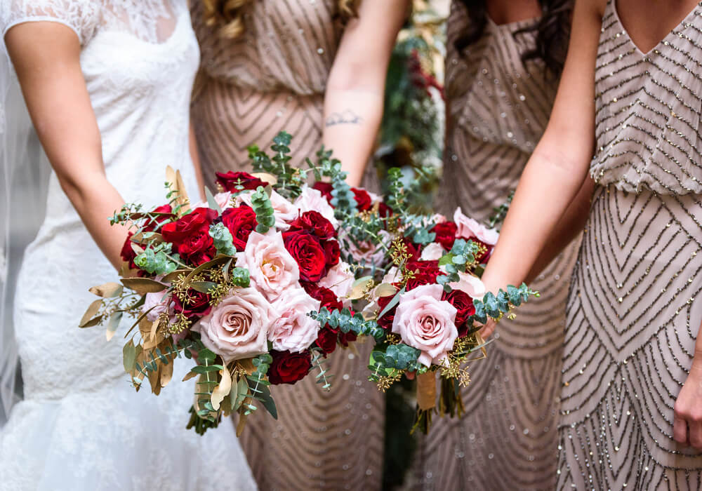 Bride and bridesmaids at a glitz and glamour themed winter wedding
