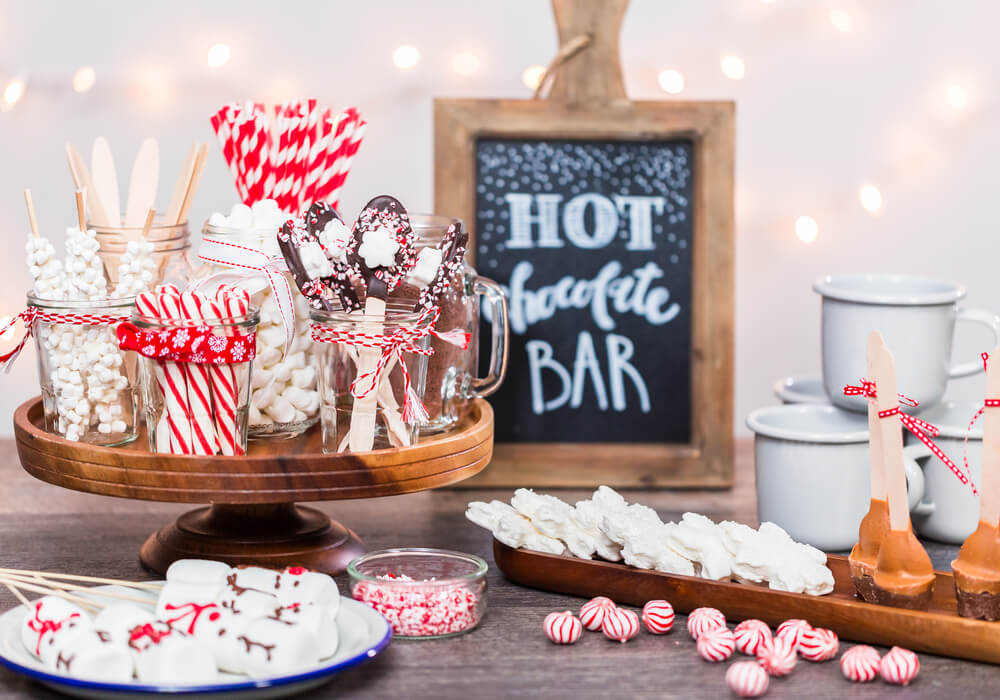 Different toppings at a hot chocolate bar at a wedding