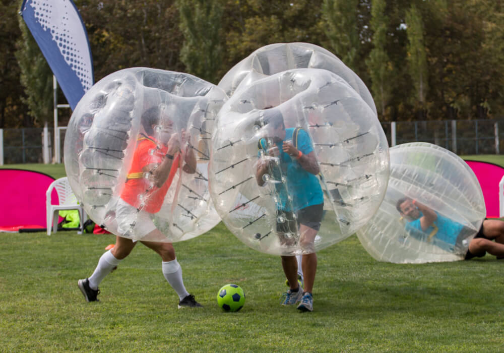 People enjoying the top stag do activity bubble football