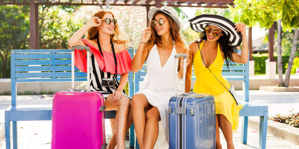 Group of women going on holiday wearing brightly coloured clothing