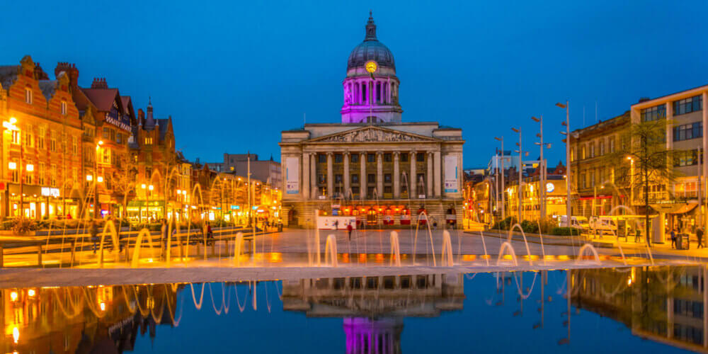 Nottingham Town Hall and fountains at night