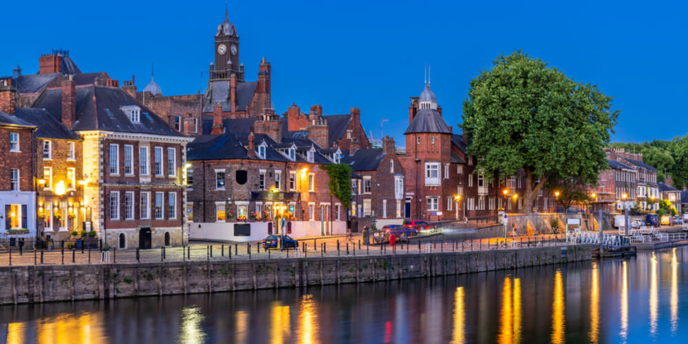 Image of York cityscape along river in the evening